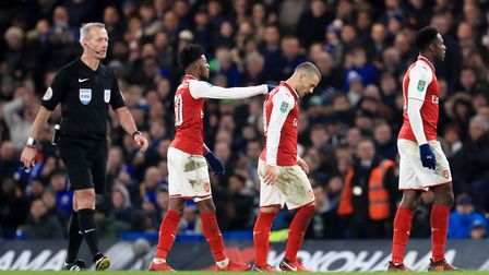 Arsenal's Jack Wilshere (centre) leaves the pitch injured during the Carabao Cup Semi Final, First L