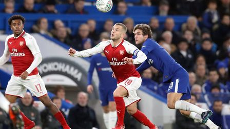 Arsenal's Jack Wilshere and Chelsea's Marcos Alonso (right) battle for the ball during the Carabao C