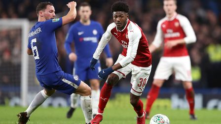 Arsenal's Ainsley Maitland-Niles (right) and Chelsea's Danny Drinkwater battle for the ball during t