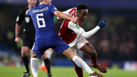 Arsenal's Danny Welbeck (right) and Chelsea's Danny Drinkwater battle for the ball during the Caraba