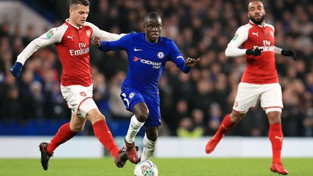 Chelsea's N'Golo Kante (centre) battles for the ball with Arsenal's Calum Chambers (left) during the