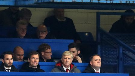 Arsenal manager Arsene Wenger (centre) and coach Jens Lehmann (second left) watch from the stands du