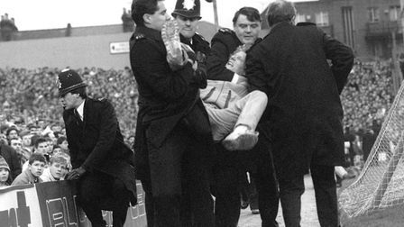 Arsenal v Millwall in January 1988. Police arrest a fan at the start of the match. Picture: PA