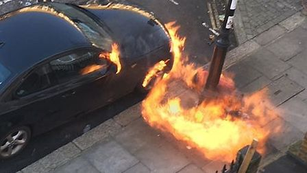 The car on fire in Offord Road.