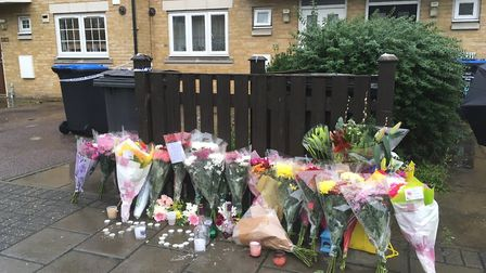 Flowers and candles left for James Owusu, gunned down outside his home on Tynesdale Road