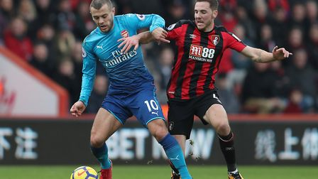 Arsenal's Jack Wilshere (left) holds off Bournemouth's Dsan Gosling during the Premier League match