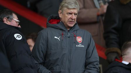 Arsenal manager Arsene Wenger takes his seat in the stands during the Premier League match at the Vi
