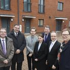 Cllrs Richard Watts and Diarmaid Ward with town hall project manager Alistair Gale (centre in grey b