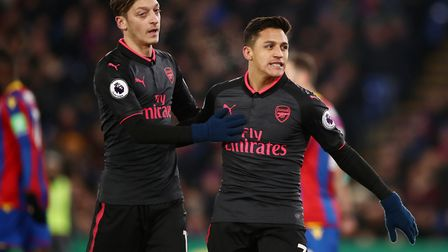 Arsenal's Alexis Sanchez (right) celebrates scoring his side's second goal of the game during the Pr