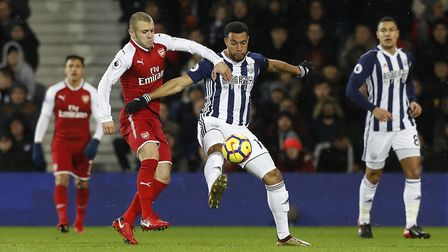 West Bromwich Albion's Matt Phillips and Arsenal's Jack Wilshere battle for the ball (pic Martin Ric