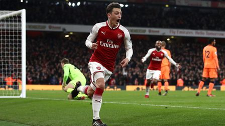 Wenger is more confident of keeping Mesut Ozil but there is still a lot of hard work to be done. Pic