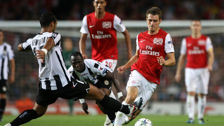 Arsenal target Mehdi Benatia in action for Udinese against Arsenal in the 2011 Champions League qual