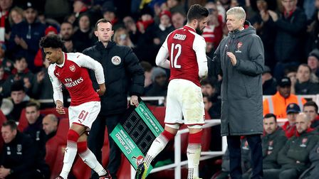 Arsenal's Olivier Giroud (centre) is replaced by Reiss Nelson (left) during the Carabao Cup quarter-