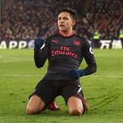 Arsenal's Alexis Sanchez celebrates scoring his side's third goal of the game during the Premier Lea