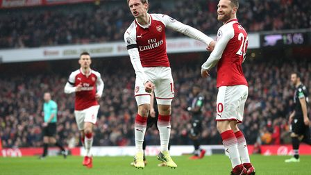Arsenal's Nacho Monreal (centre) celebrates scoring his side's first goal of the game during the Pre