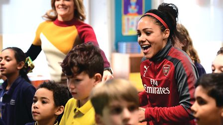 Super Movers ambassadors Gabby Logan and Alex Scott take part in a classroom session during the Prem