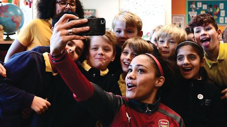 Super Movers ambassador Alex Scott takes a selfie during a classroom session during the Premier Leag