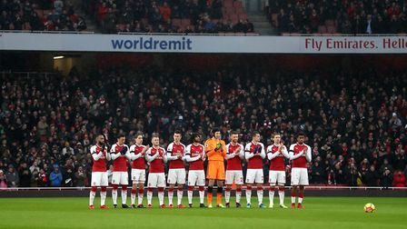 Arsenal players stand for a minutes applause in memory of the late Cyrille Regis prior to the Premie