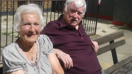 Marie 'the lady on the bench' Heywood and her husband Brian outside Ilex House in the Holly Park Est