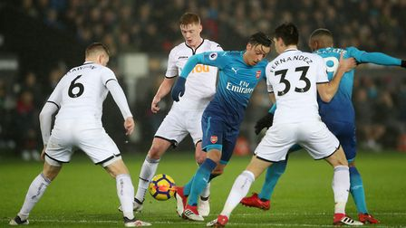 Arsenal's Mesut Ozil (centre) is surrounded by Swansea City players at the Liberty Stadium (pic Nick