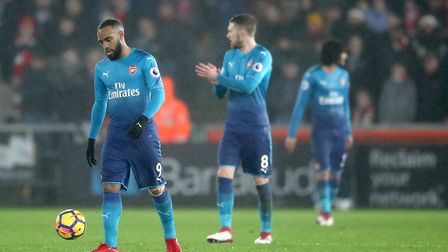 Arsenal's Alexandre Lacazette and Aaron Ramsey react after Swansea City equalise at the Liberty Stad