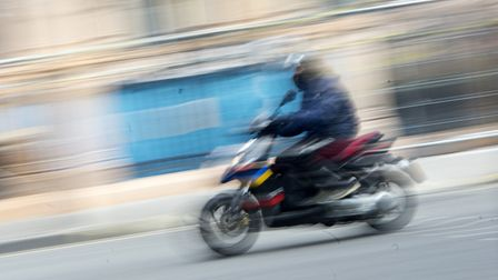 A stock moped rider image. Picture: Victoria Jones/PA