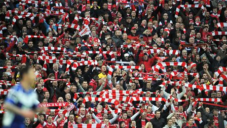 Arsenal fans show their support in the stands during the 2011 League Cup final. PA
