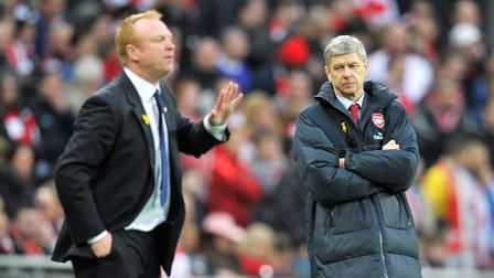 Birmingham City manager Alex McLeish is glared at by Arsenal manager Arsene Wenger during the 2011 L