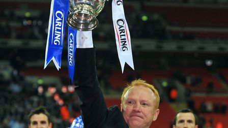 Alex McLeish, Birmingham City manager lifts the 2011 League Cup in triumph after beating Arsenal