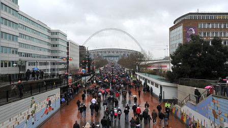 Arsenal and Birmingham City fans make their way up Wembley Way before the match