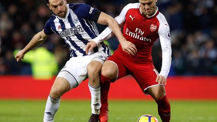 Arsenal wore red shorts against West Brom in December. Pictured Jack Wilshere battles for the ball a