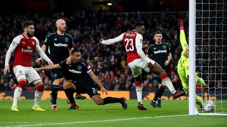 Arsenal's Danny Welbeck (23) scores against West Ham in the Carabao Cup Quarter Final at the Emirate
