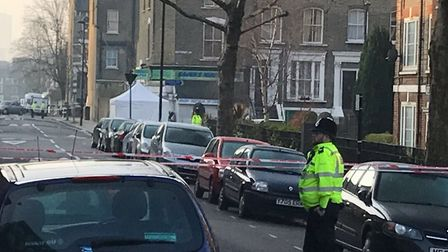 Police at the scene where a teenager was stabbed to death in Bartholomew Road (Picture: Emily Banks)