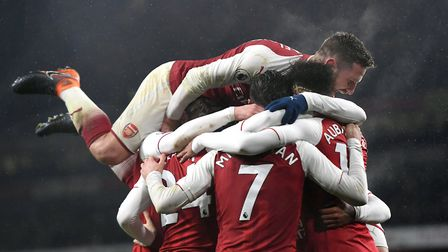 Arsenal players celebrate after Pierre-Emerick Aubameyang (right) scores his side's fourth goal of t