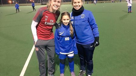 Arsenal's inspirational Heather O'Reilly with Gemma Smith and a keen youngster from Hitchin Belles