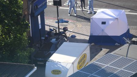 A forensic tent at the scene of the attack in June last year, where Makram Ali, 51, died. Picture: V