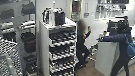 Sheraji threatening the staff member with a knife. Picture: Met Police
