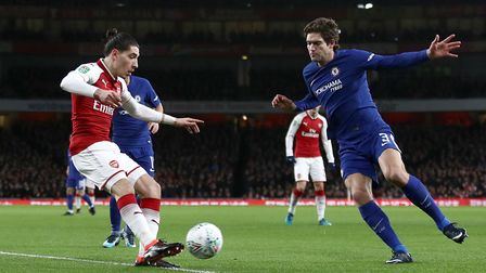 Arsenal's Hector Bellerin (left) and Chelsea's Marcos Alonso battle for the ball during the Carabao
