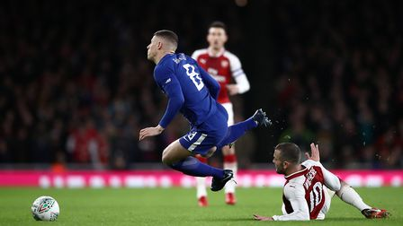 Chelsea's Ross Barkley (left) and Arsenal's Jack Wilshere battle for the ball during the Carabao Cup