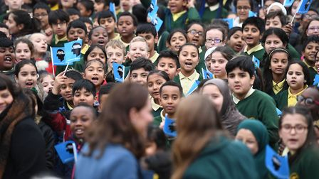 Crowds of children greet the Duchess of Cambridge (front)arriving at Roe Green Junior School Photo