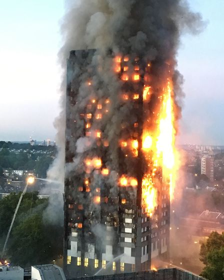 Fire engulfs Grenfell Tower in Kensington in June. Seventy-one people died in the blaze. Picture: Na