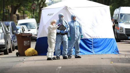 Forensics officers by a police tent in the middle of Sunnyside Road after Dawood's shooting, August