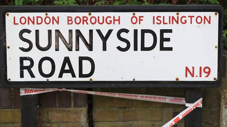 Police tape on a Sunnyside Road sign in the aftermath of the shooting. Picture: Jonathan Brady/PA Ar