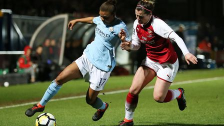 Arsenal's Emma Mitchell and Manchester City Women's Nikita Parris battle for the ball (pic Nigel Fre