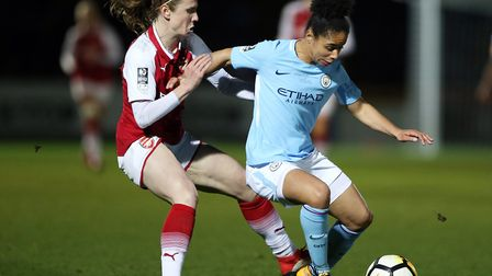 Arsenal's Heather O'Reilly (left) and Manchester City Women's Demi Stokes battle for the ball (pic N