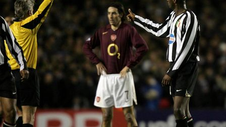 Juventus' Patrick Vieira (R) receives a yellow card from referee Peter Frojdfeldt during the UEFA Ch