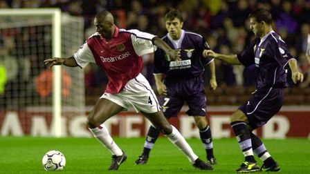 Arsenals Patrick Vieira (left) sends the Lazio defence the wrong way in the Champions League Group B