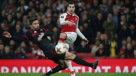 Henrikh Mkhitaryan puts a cross in to the box in the Europa League match between Arsenal and A.C. Mi