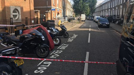 Police taped off Mitchison Road, off Essex Road, in Canonbury following the stabbing. Picture: James