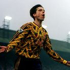 Arsenal legend Alan Smith celebrates a goal in 1993 wearing the 'bruised banana' away top. The shirt